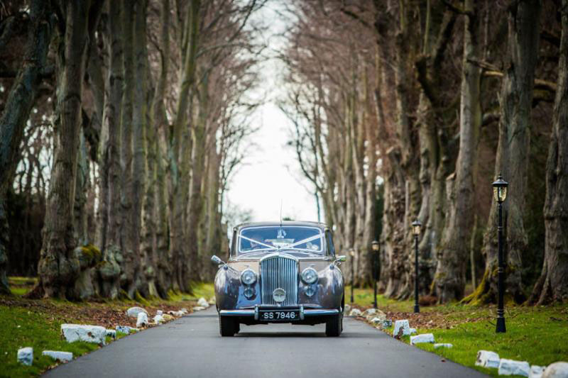 Wedding car coming down drive at Carberry