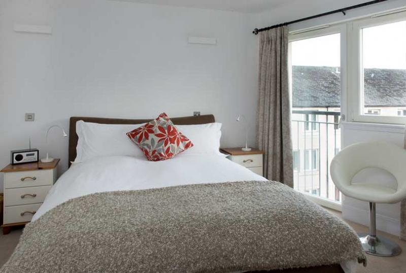 Main bedroom at Dean Park Mews